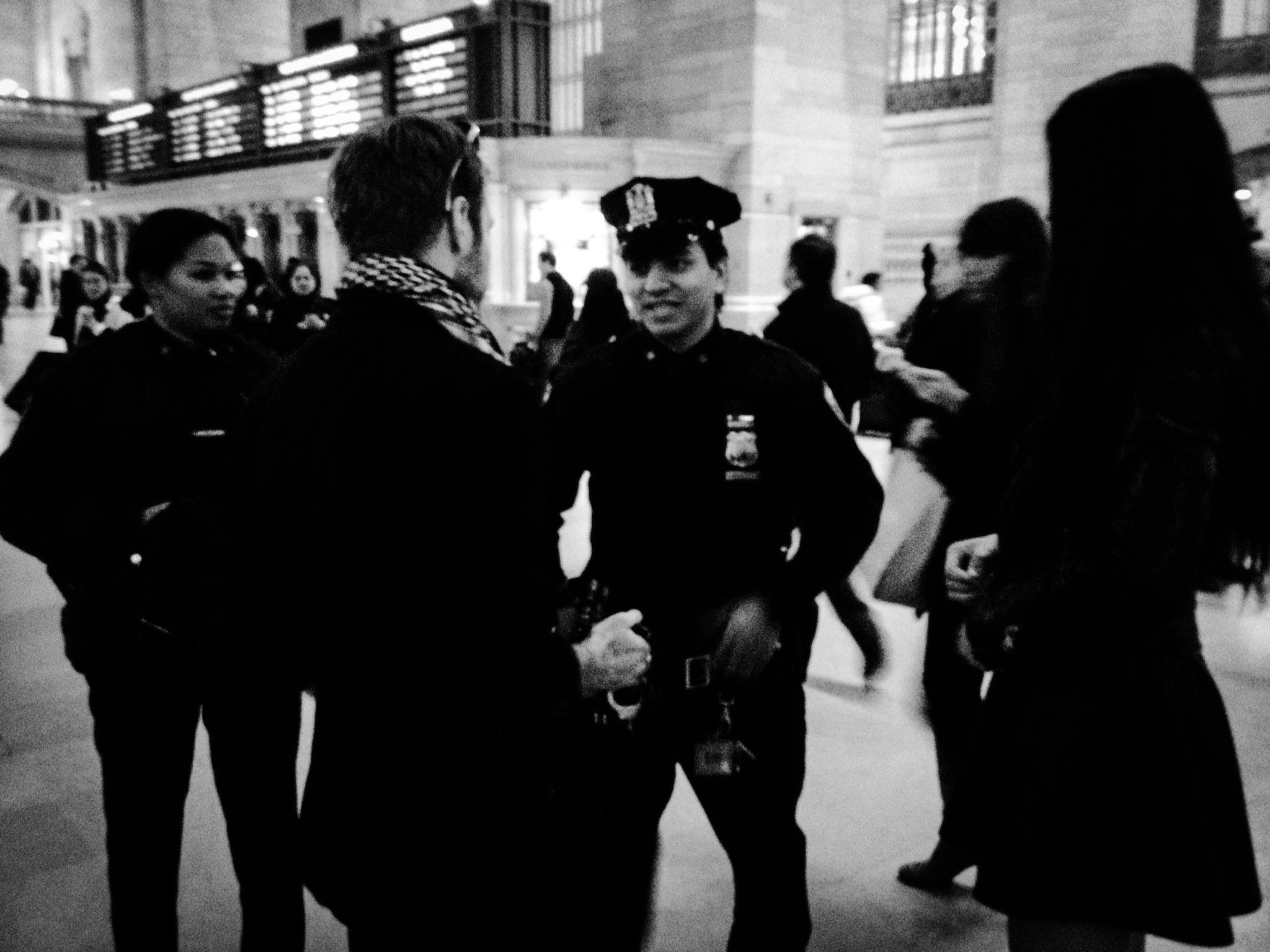 Allen Henson and Serina Thai talking to officers at Grand Central