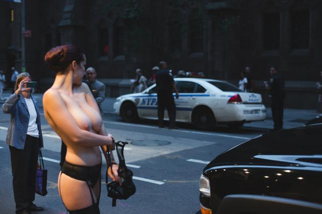An earlier photo where Allen Henson and topless model friend were approached by police and left alone.